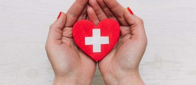 crop-hands-holding-heart-with-cross_23-2147796552