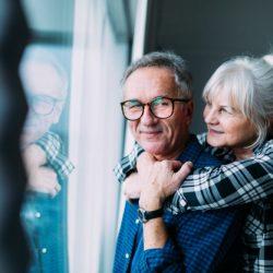 happy-elderly-couple-retirement-home_23-2147817091