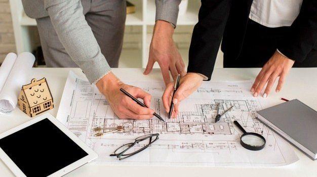 man-woman-drawing-house-plan_23-2148252112